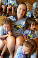 "Counselor ""Belle"" with three campers"